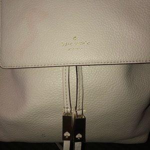 Kate Spade cream colored backpack purse